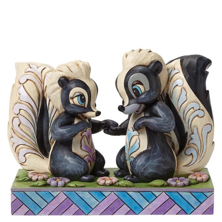 Flower and Miss Skunk Figurine